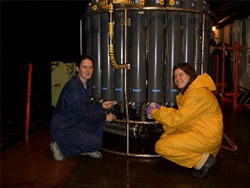Susan Leadbetter (left) and Rhiannon Mather (right) taking samples of water on the RRS Charles Darwin.